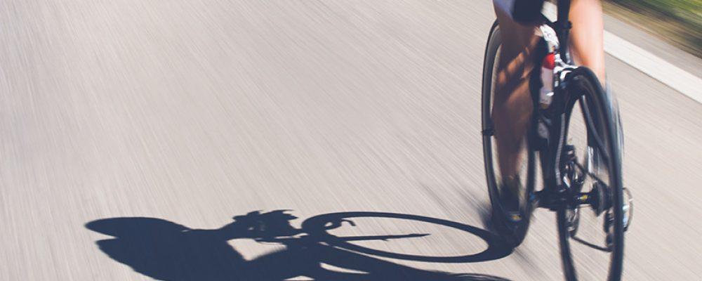 Speedy shadow - A cyclist at top speed on the triathlon race.